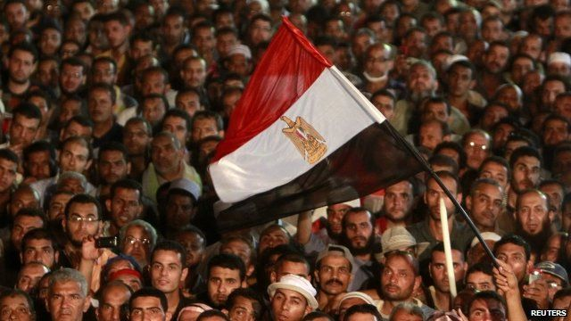 Pro-Morsi protesters with flag