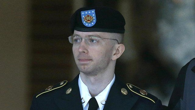 Bradley Manning is escorted to a security vehicle outside the courthouse in Fort Meade