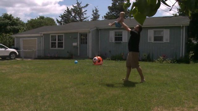 Man with child outside New Jersey home