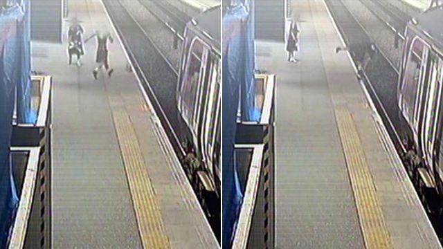 Man tumbles onto a railway track