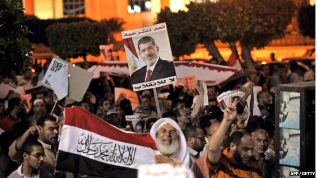 President Mohammed Morsi supporters hold a demonstration against the government in Cairo on July 31, 2013