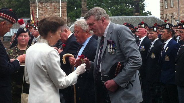 The Princess Royal hands out roses