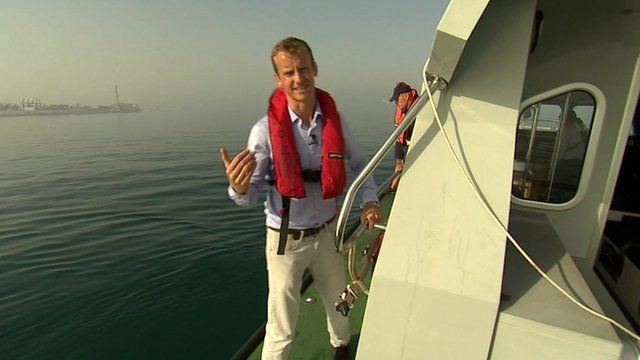 The BBC's Tom Burridge on a boat in the sea off the coast of Gibraltar