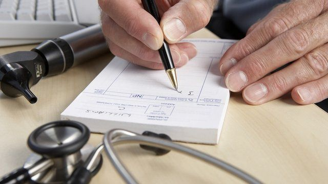 Doctor writing prescription notes