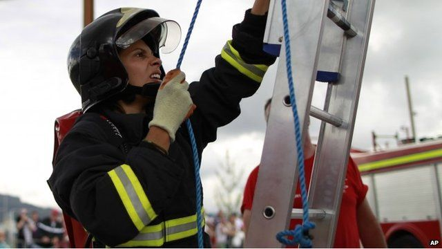 Brazilian firefighter Gabriela Oliveira takes part in the Ultimate Firefighter contest during the World Police and Fire Games in Belfast
