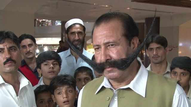 Malik Afridi and his extended moustache