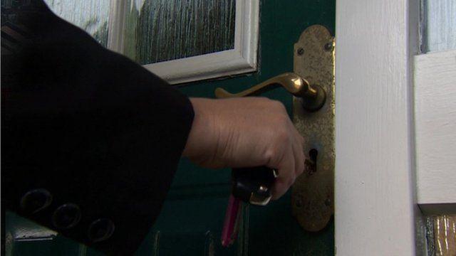 A front door being unlocked