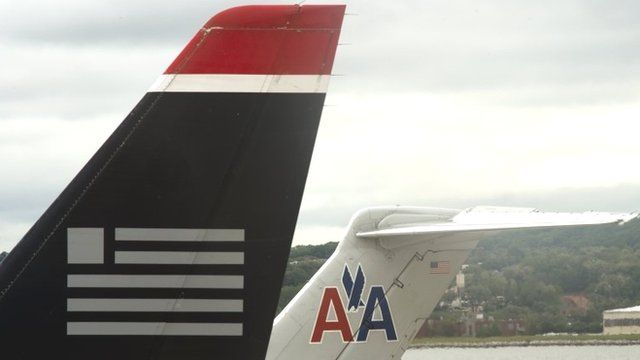 US Airways and American Airlines plane tails