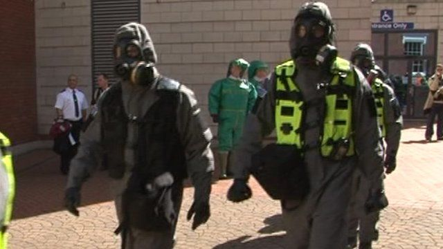 People dressed with breathing apparatus