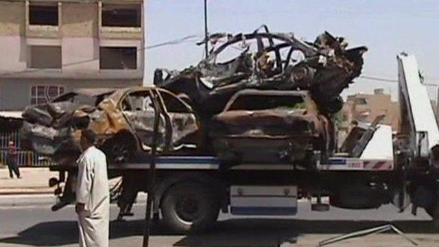 Burnt-out vehicles in Baghdad