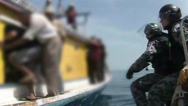 Australian authorities alongside an asylum boat