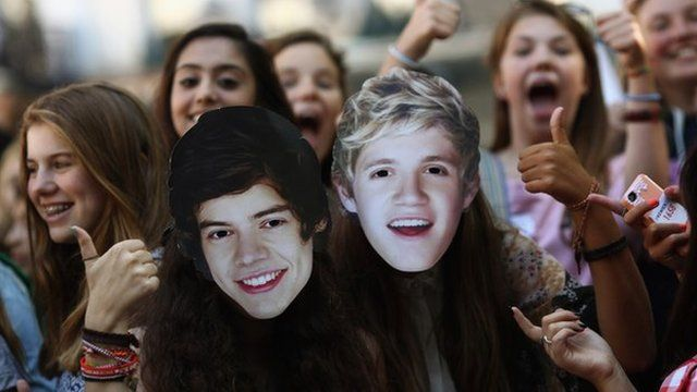 One Direction fans wearing Harry and Niall masks