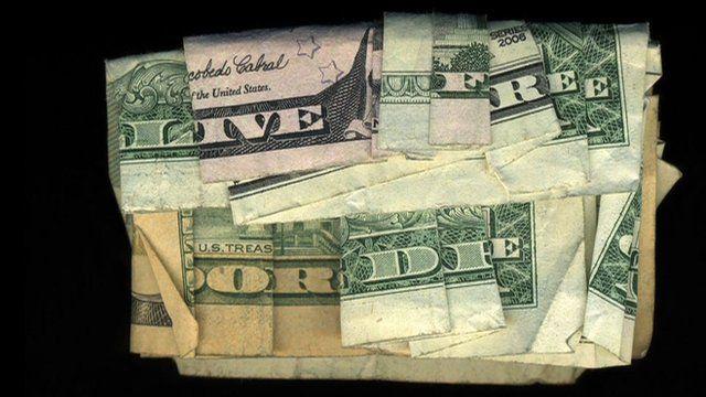 """Live free or die"" written using folded dollar bills"
