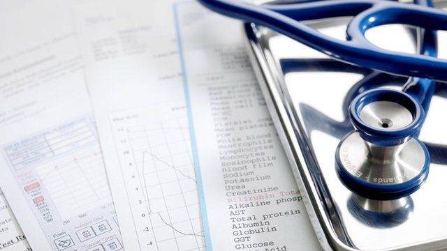 Medical paperwork and a stethoscope