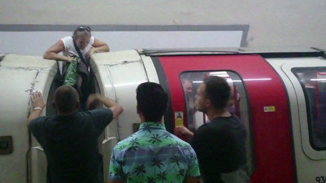 Woman climbs out of a Tube window