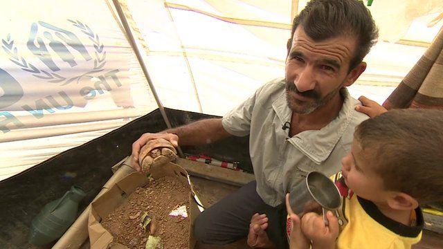 Mahmood Mahamid with his son and pet tortoise