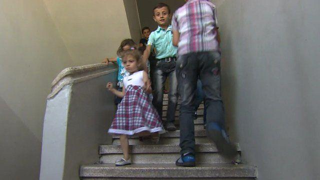 Children play in stairwell