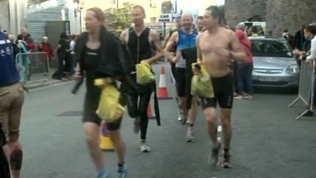 Runners in Ironman Wales