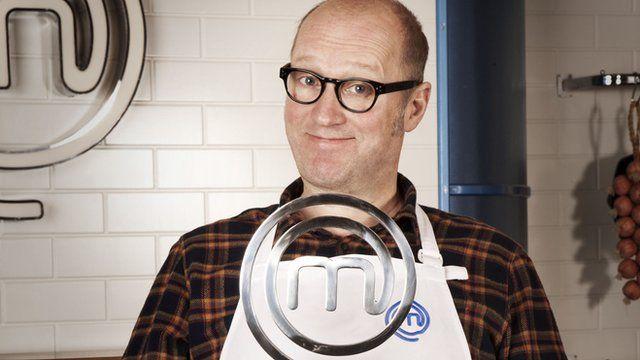 Ade Edmonson with the Celebrity Masterchef trophy