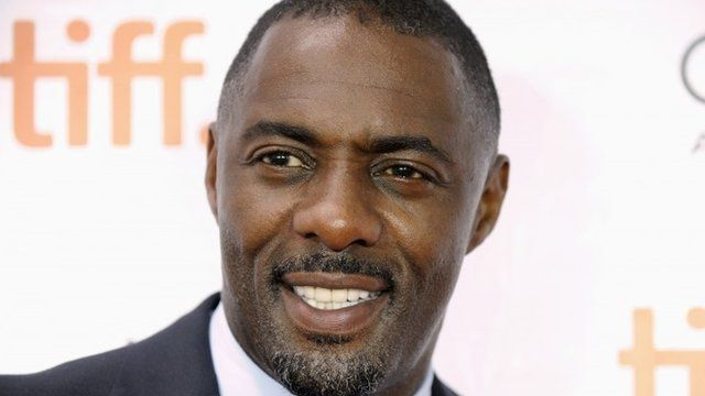 """Cast member Idris Elba poses on the red carpet before a screening of the film """"Mandela: Long Walk to Freedom"""""""