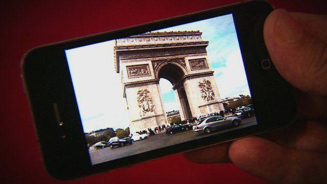 Mobile phone displaying photo