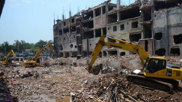 May 13, 2013, Bangladeshi Army personnel use heavy equipment as they continue to clear debris after an eight-storey building collapsed in Savar, on the outskirts of Dhaka.