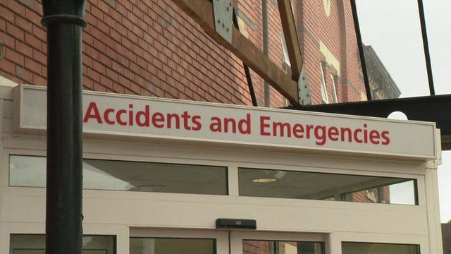 A white sign with read writing reading Accidents and Emergencies