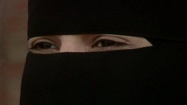 A woman's eyes through a niqab (face-veil)