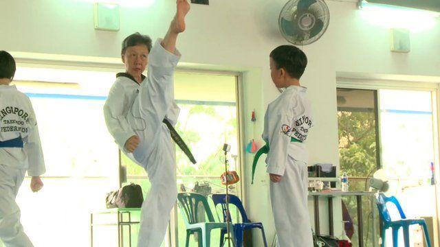 Sister Linda Sim demonstrating a high kick