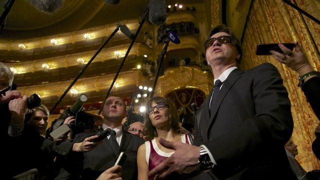 Artistic director of the Bolshoi ballet Sergei Filin, right, speaks to the media after a traditional annual meeting of the Bolshoi Theater in Moscow, Russia