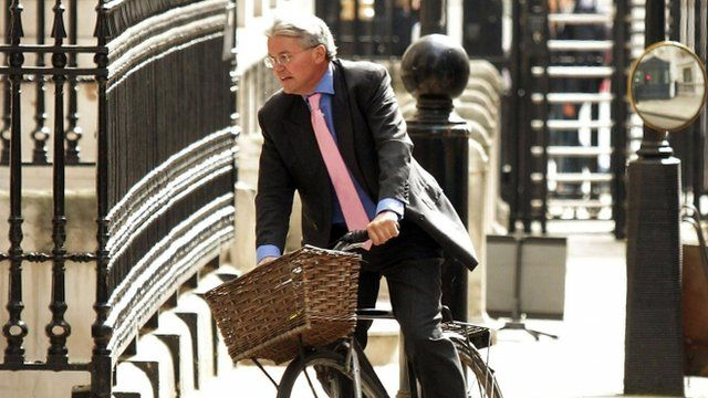 File photo of Andrew Mitchell riding his bike in 2011