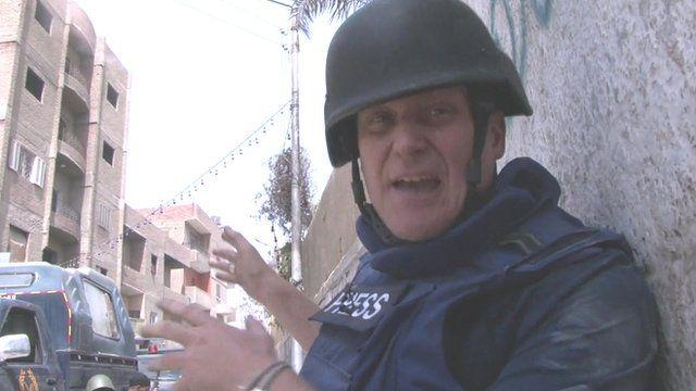The BBC's Quentin Sommerville as a gun battle rages around him