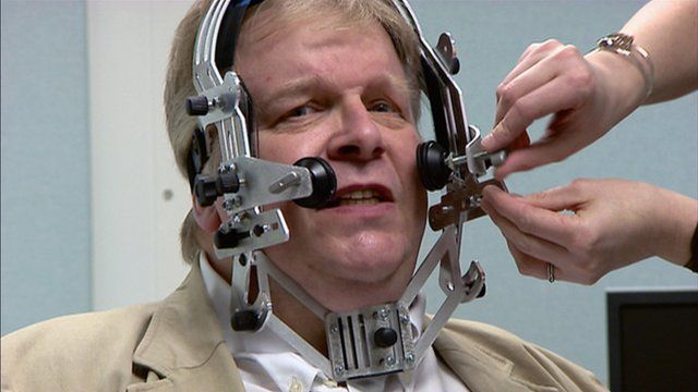 Kenneth Macdonald wears a facial scanner