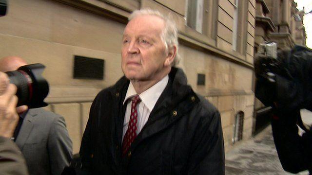 Bill Walker walking to court