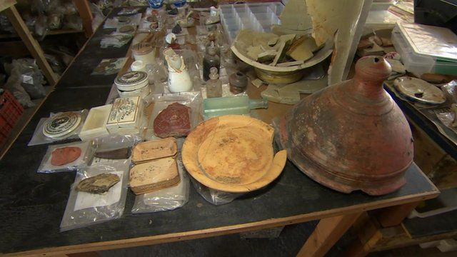 Artefacts laid out on table