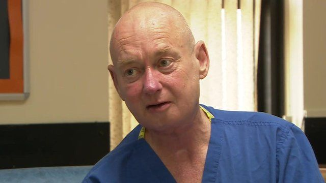 Jim Doyle in hospital scrubs