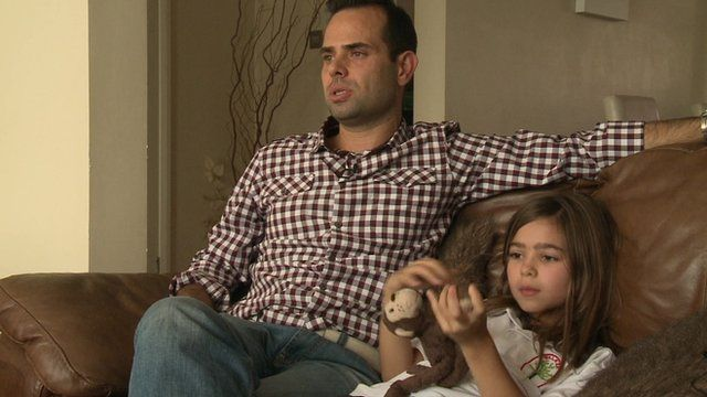 Costas Kariolis and his daughter, who racked up a £300 smartphone bill from in-app purchasing