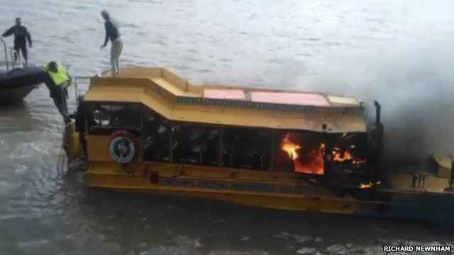 People on roof of Ducktours boat on fire