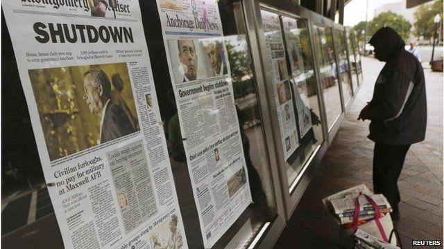 Man reads morning newspapers from around the United States