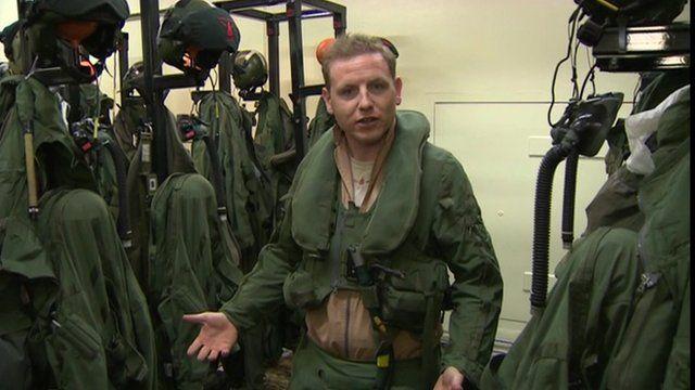 Flight Lieutenant Al Spence surrounded by kit