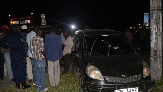 Crowds gather around the car in Mombassa