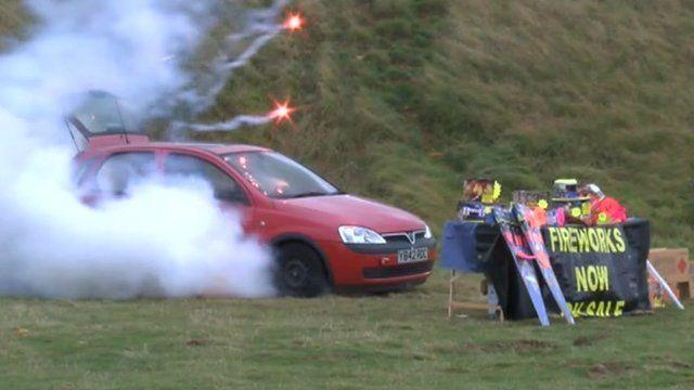 Fireworks exploding inside a car
