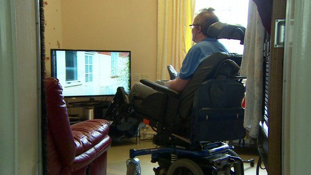 Multiple Sclerosis patient Richard Stapely watching television