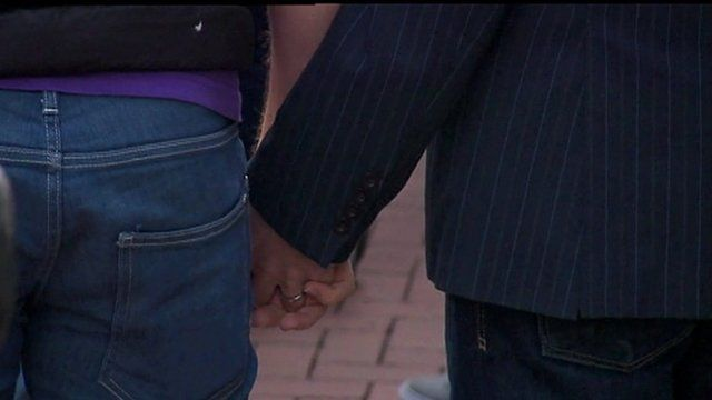 Gay couple holding hands