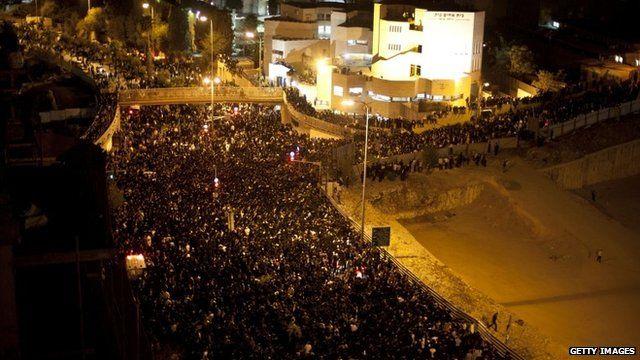 Jewish mourners observe the funeral of Rabbi Ovadia Yosef