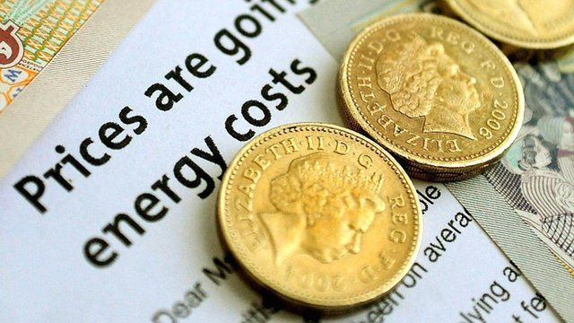 Coins and an energy bill