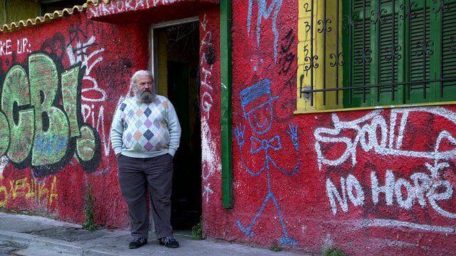 Artist Leo standing in the shelter's doorway