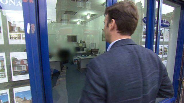 BBC reporter Guy Lynn outside an estate agent