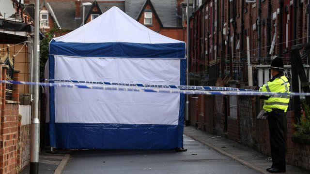 Police at the scene at Back Hill Top Avenue in Leeds
