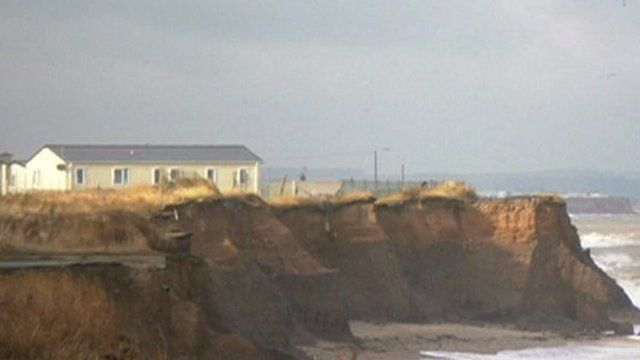 House on crumbling cliff top